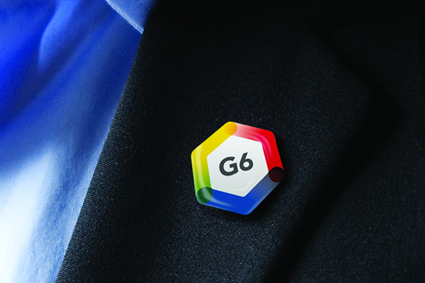 G6 Summit logo-mark shown as lapel pin
