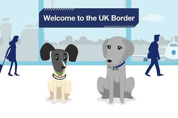 Still image from the Design102 animation showreel featuring work from their Border Paws animation work for Border Force. Two different types of illustrated dog are positioned against an illustration of an airport arrivals area, beneath a banner sign that reads 'Welcome to the UK border'.